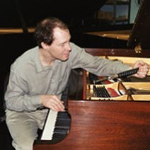 Christopher Haberbosch puts finishing touches on grand piano.
